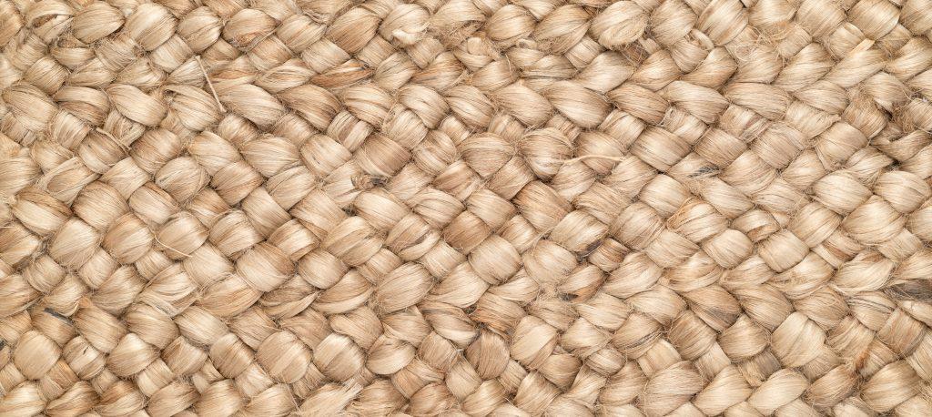 Sisal variety woolen carpet has a textured loop pile in straight rows.